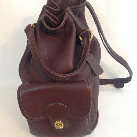 Coach Handbags - Coach Brown Leather Turnlock Drawstring Backpack